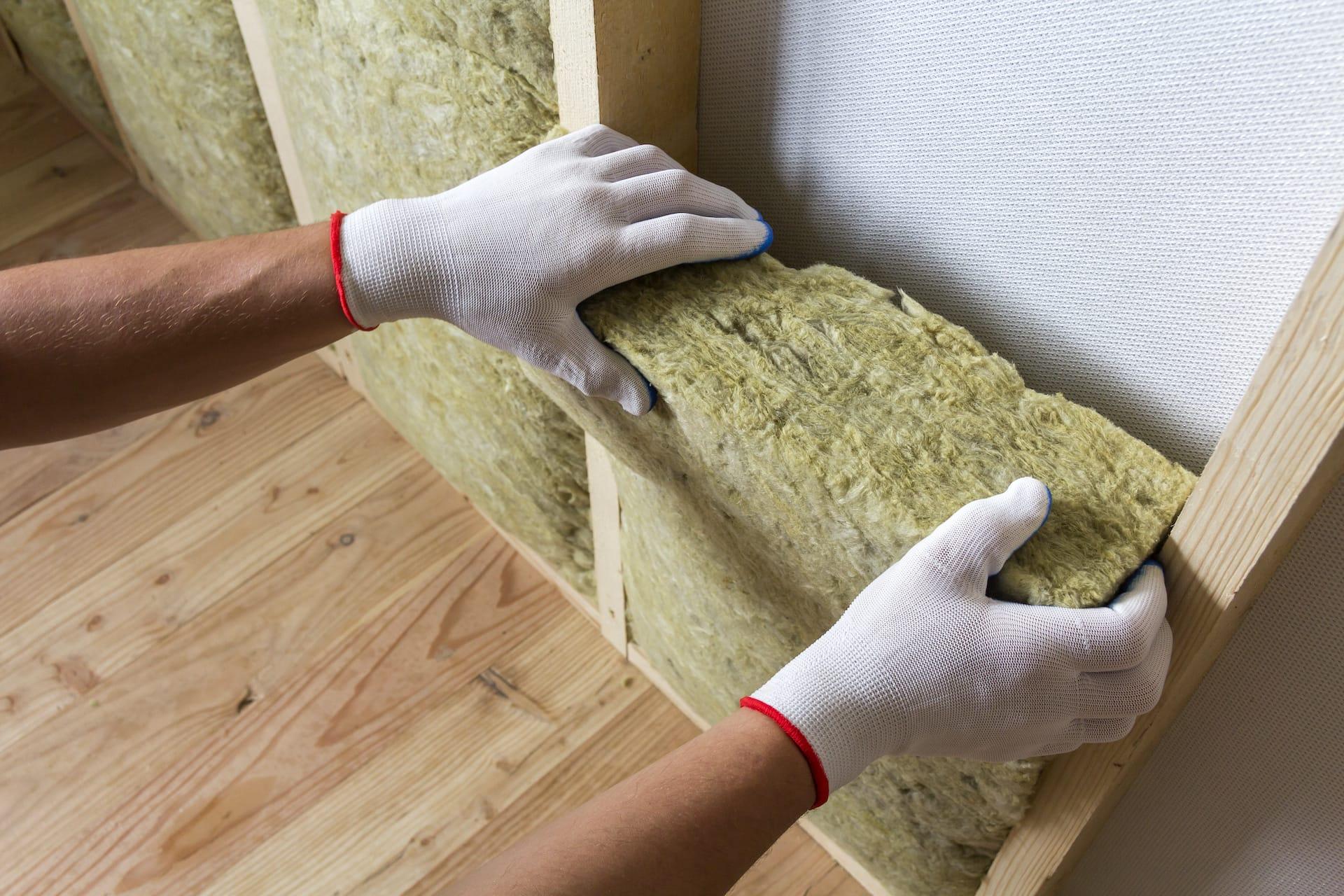 worker installing foam board home insulation