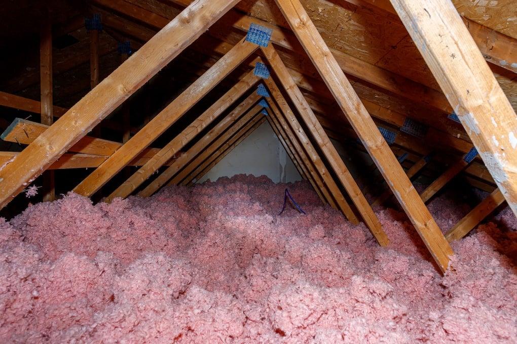 Attic with loose-fill fiberglass insulation
