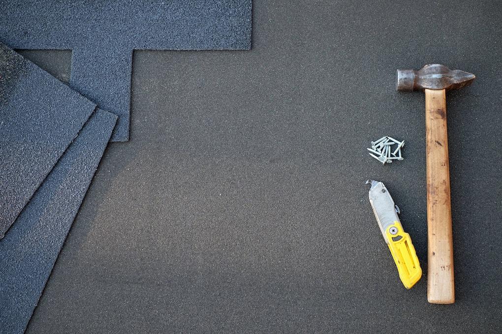 roofing tools on asphalt roof